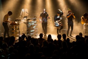 Amsterdam, The Netherlands – 16 March, 2016: concert of French electro swing band Caravan Palace at venue Melkweg. View on the stage with band members performing in front of their cheering audience